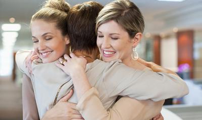women hugging 2_ibe_586x417-crop-u1215