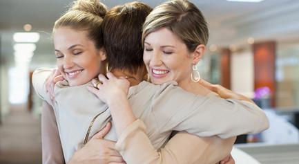 women hugging 2 ibe 586x417 crop u1215 e1476818896738 The Healing Power of Generosity